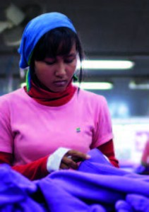 An adidas worker in Cambodia producing goods for the London Olympics / Credit: Will Baxter