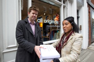 adidas accept their petition postcards from Playfair campaign supporters.